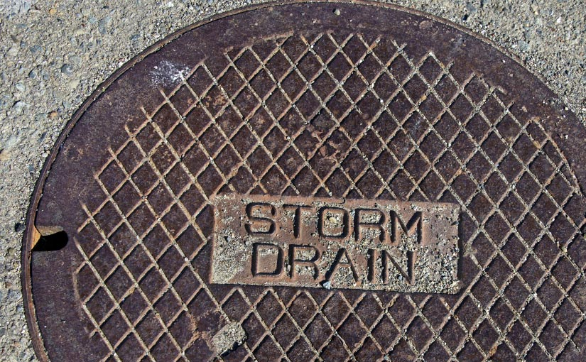A manhole cover labeled Storm Drain